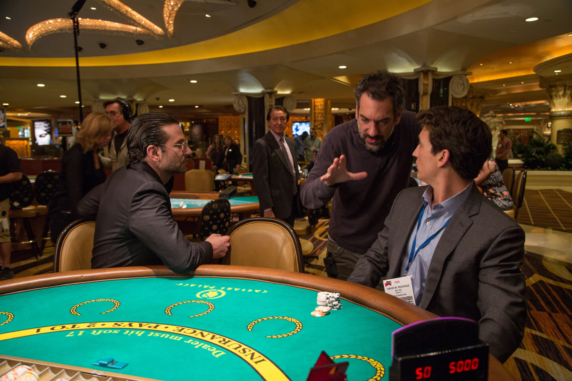 """Actor/producer BRADLEY COOPER, director/writer/producer TODD PHILLIPS and MILES TELLER on the set of Warner Bros. Pictures' comedic drama (based on true events) """"WAR DOGS,"""" a Warner Bros. Pictures release."""