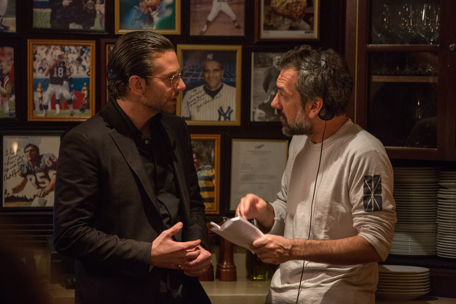 """Actor/producer BRADLEY COOPER and director/writer/producer TODD PHILLIPS on the set of Warner Bros. Pictures' comedic drama (based on true events) """"WAR DOGS,"""" a Warner Bros. Pictures release."""