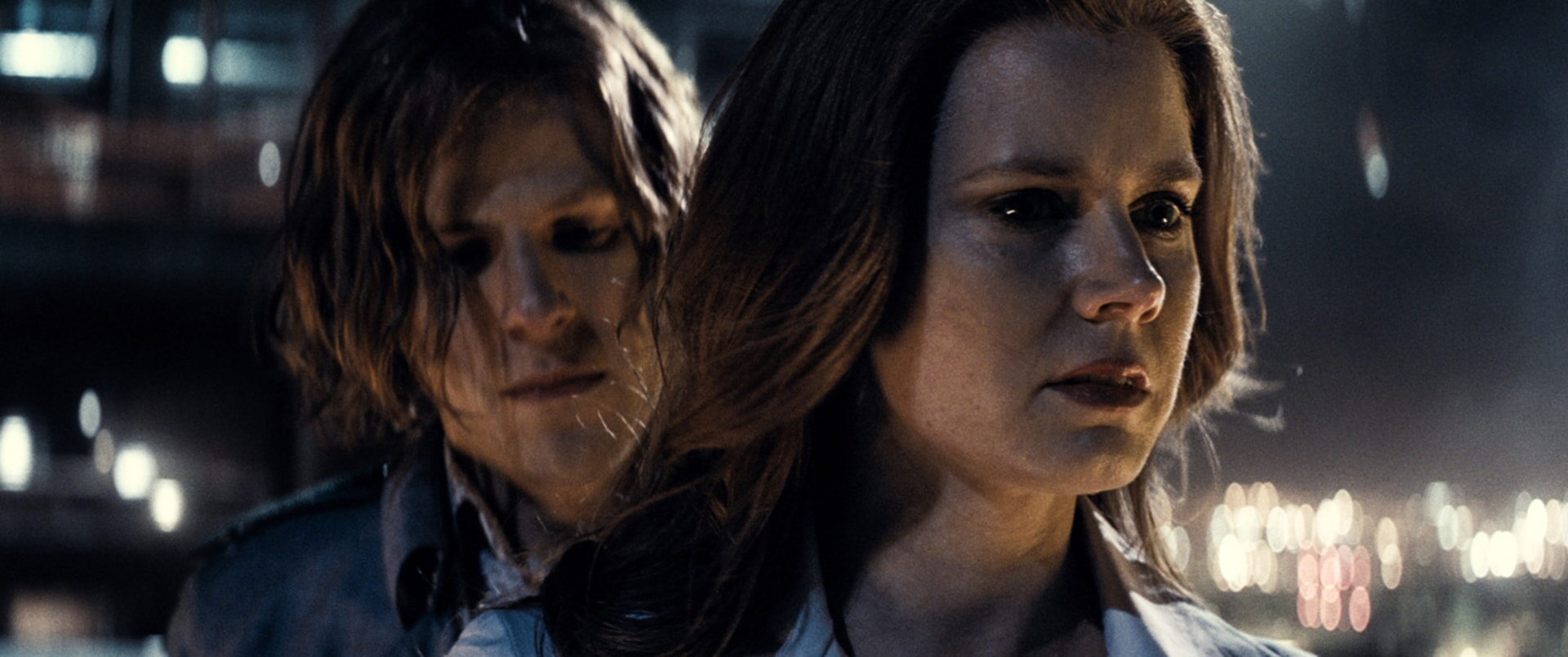 Close-up of JESSE EISENBERG as Lex Luthor and AMY ADAMS as Lois Lane