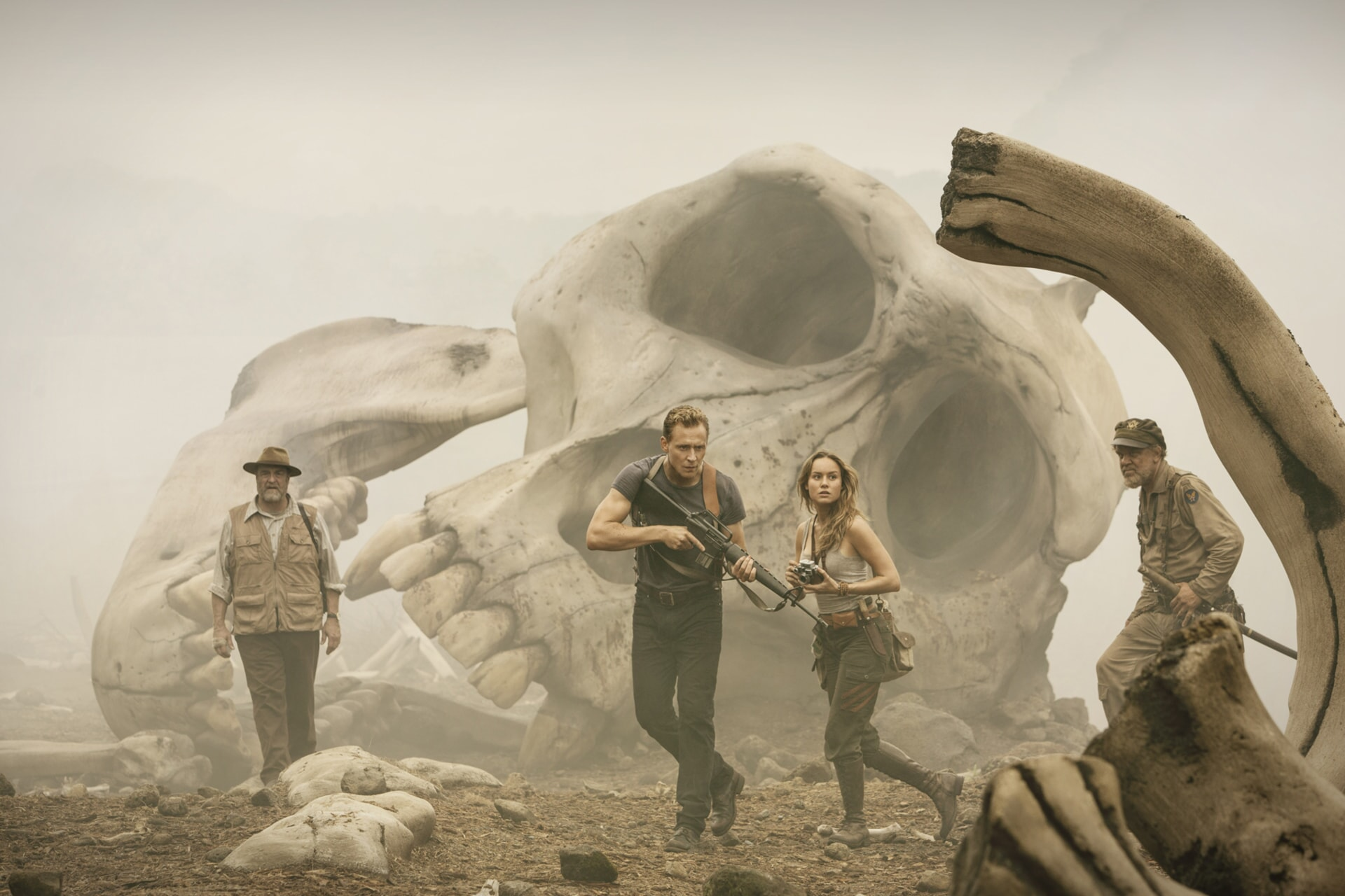 """JOHN GOODMAN as Randa, TOM HIDDLESTON as Conrad, BRIE LARSON as Mason and JOHN C. REILLY as Marlow in Warner Bros. Pictures' and Legendary Pictures' action adventure """"KONG: SKULL ISLAND,"""" a Warner Bros. Pictures release."""