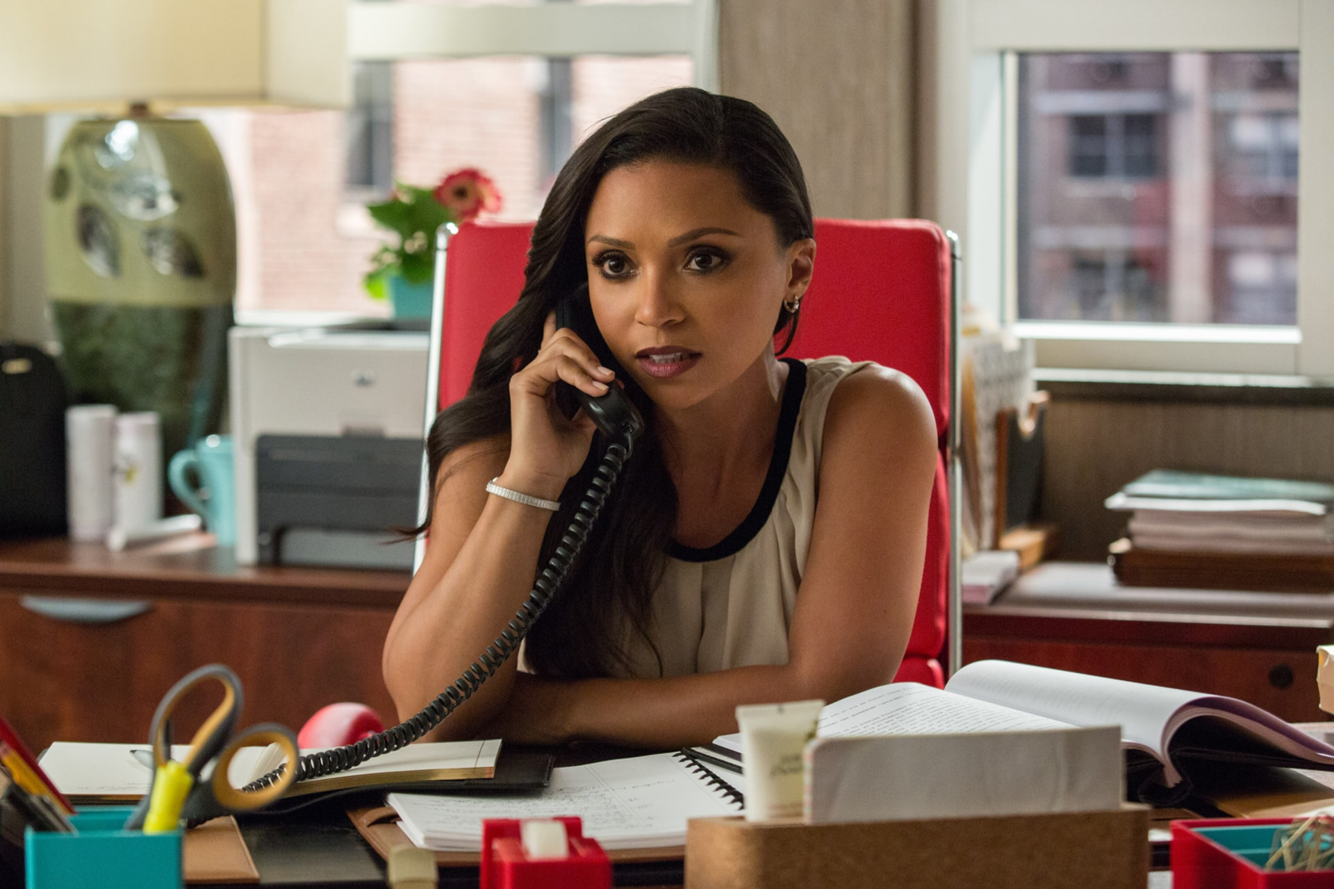 DANIELLE NICOLET as Maggie in an office on the telephone