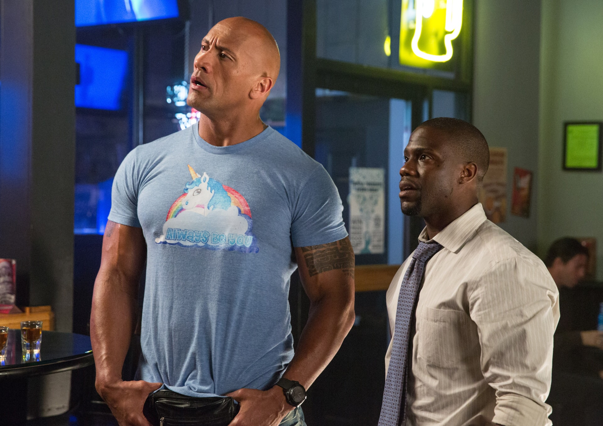 DWAYNE JOHNSON as Bob and KEVIN HART as Calvin standing in a restaurant