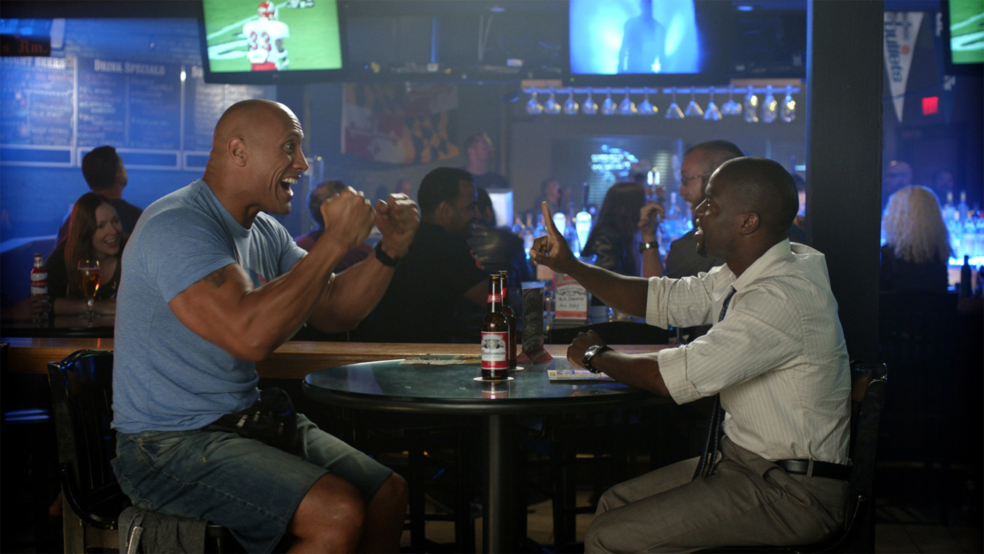 DWAYNE JOHNSON as Bob and KEVIN HART as Calvin laughing together in a restaurant