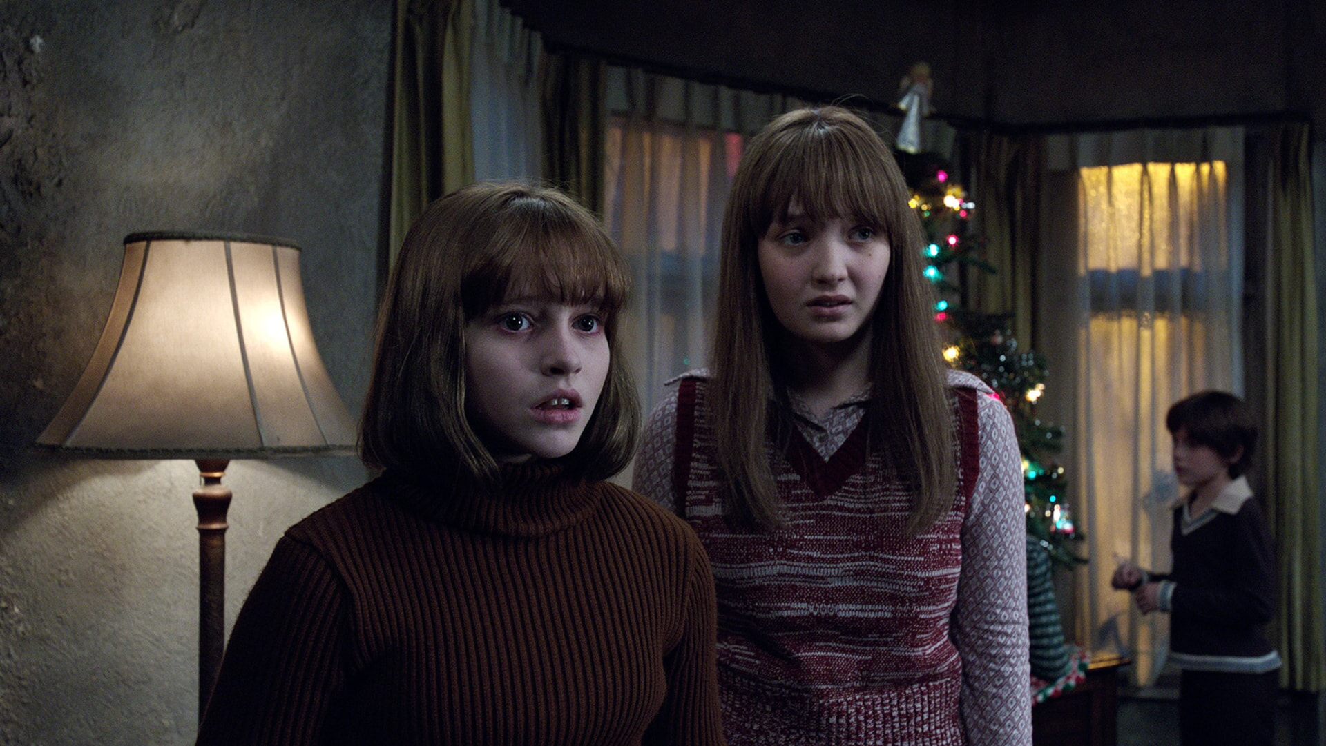 MADISON WOLFE as Janet Hodgson, LAUREN ESPOSITO as Margaret Hodgson and PATRICK McAULEY as Johnny Hodgson in a home with a Christmas tree
