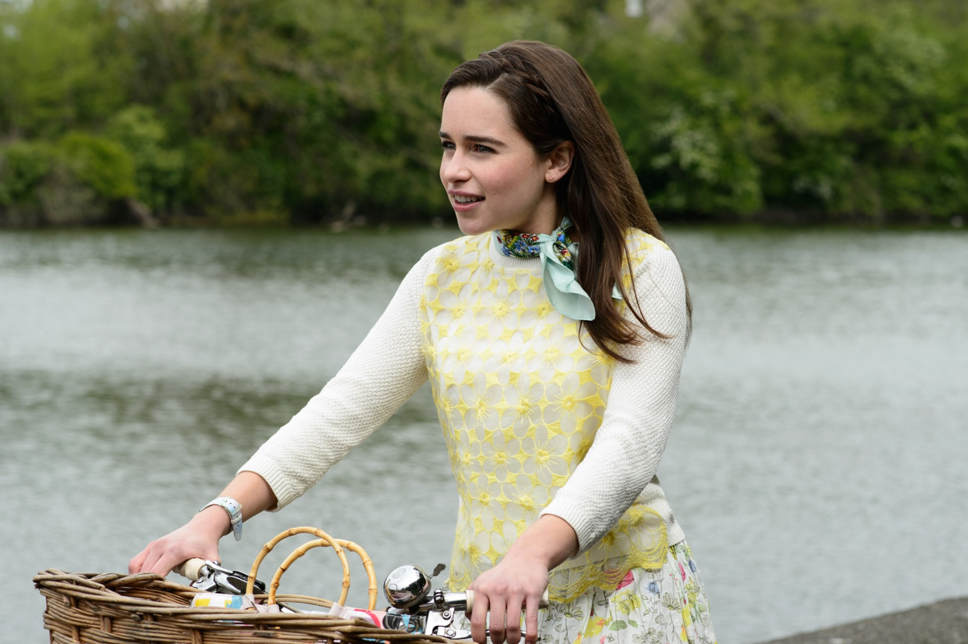 EMILIA CLARKE as Lou Clark with a bicycle and basket
