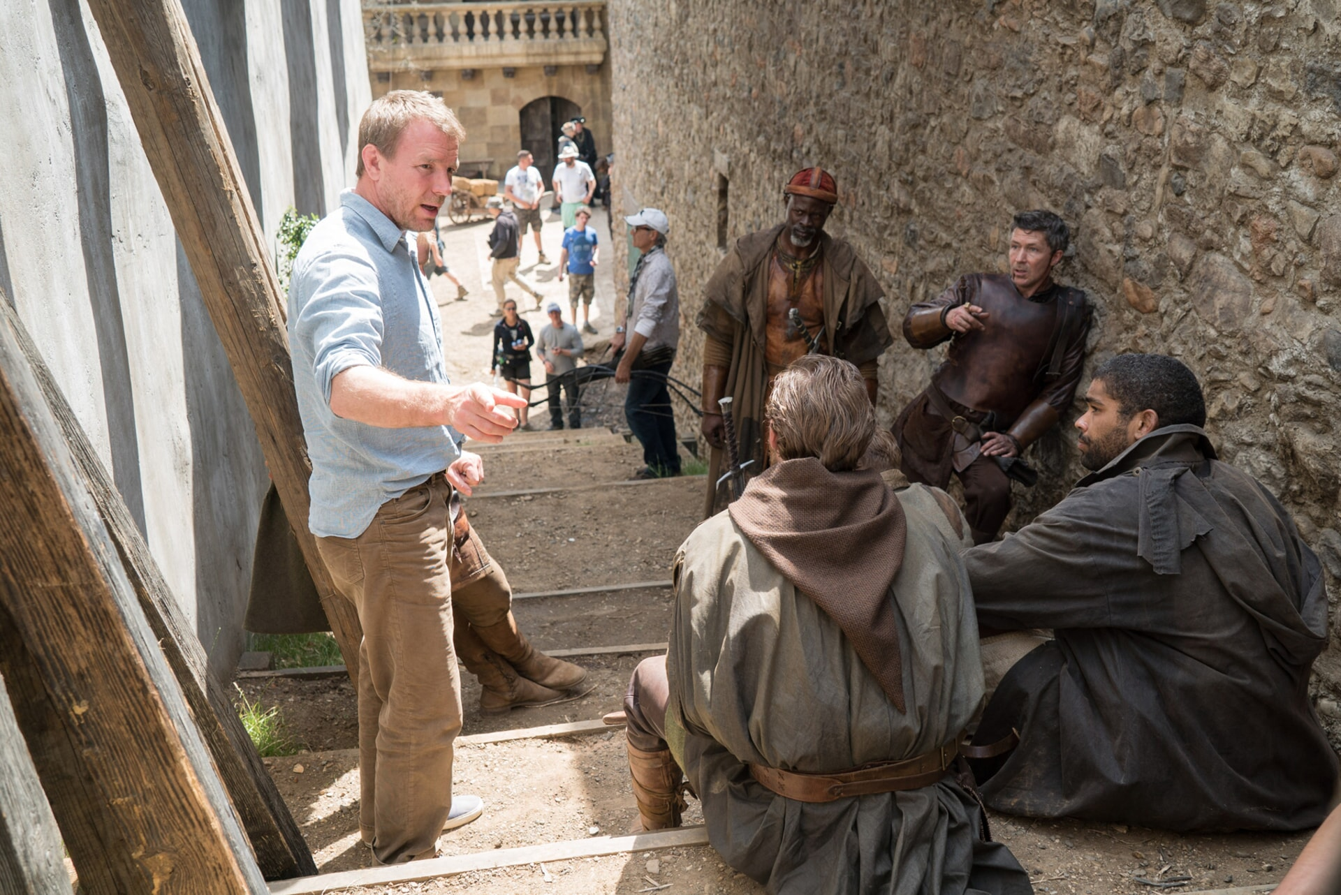 "Director/screenwriter/producer GUY RITCHIE, CHARLIE HUNNAM, KINGSLEY BEN-ADIR, AIDAN GILLEN and DJIMON HOUNSOU on the set of Warner Bros. Pictures' and Village Roadshow Pictures' fantasy action adventure ""KING ARTHUR: LEGEND OF THE SWORD,"" distributed worldwide by Warner Bros. Pictures and in select territories by Village Roadshow Pictures."
