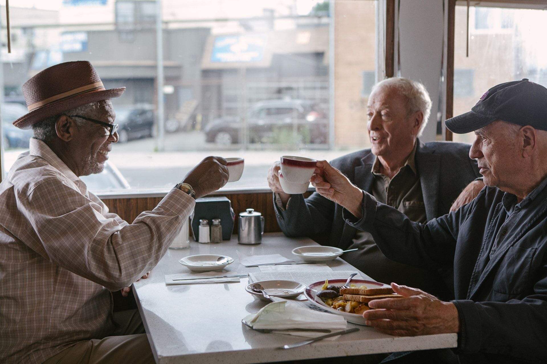 """MORGAN FREEMAN as Willie, MICHAEL CAINE as Joe and ALAN ARKIN as Al in the New Line Cinema comedy """"GOING IN STYLE,"""" a Warner Bros. Pictures release."""