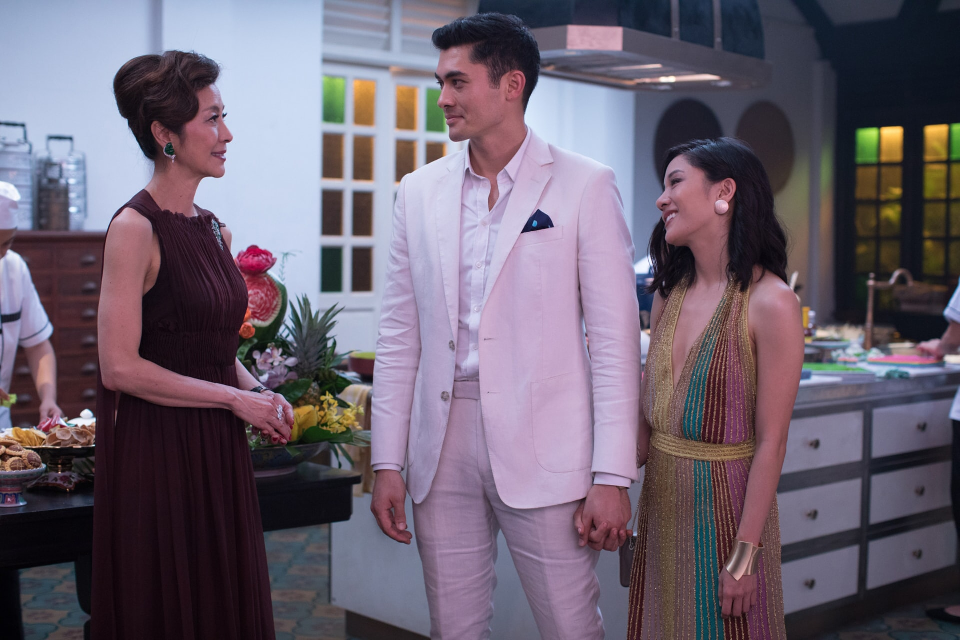 """(L-R) MICHELLE YEOH as Eleanor, HENRY GOLDING as Nick and CONSTANCE WU as Rachel in Warner Bros. Pictures' and SK Global Entertainment's contemporary romantic comedy """"CRAZY RICH ASIANS,"""" a Warner Bros. Pictures release. Photo Credit: Sanja Bucko"""