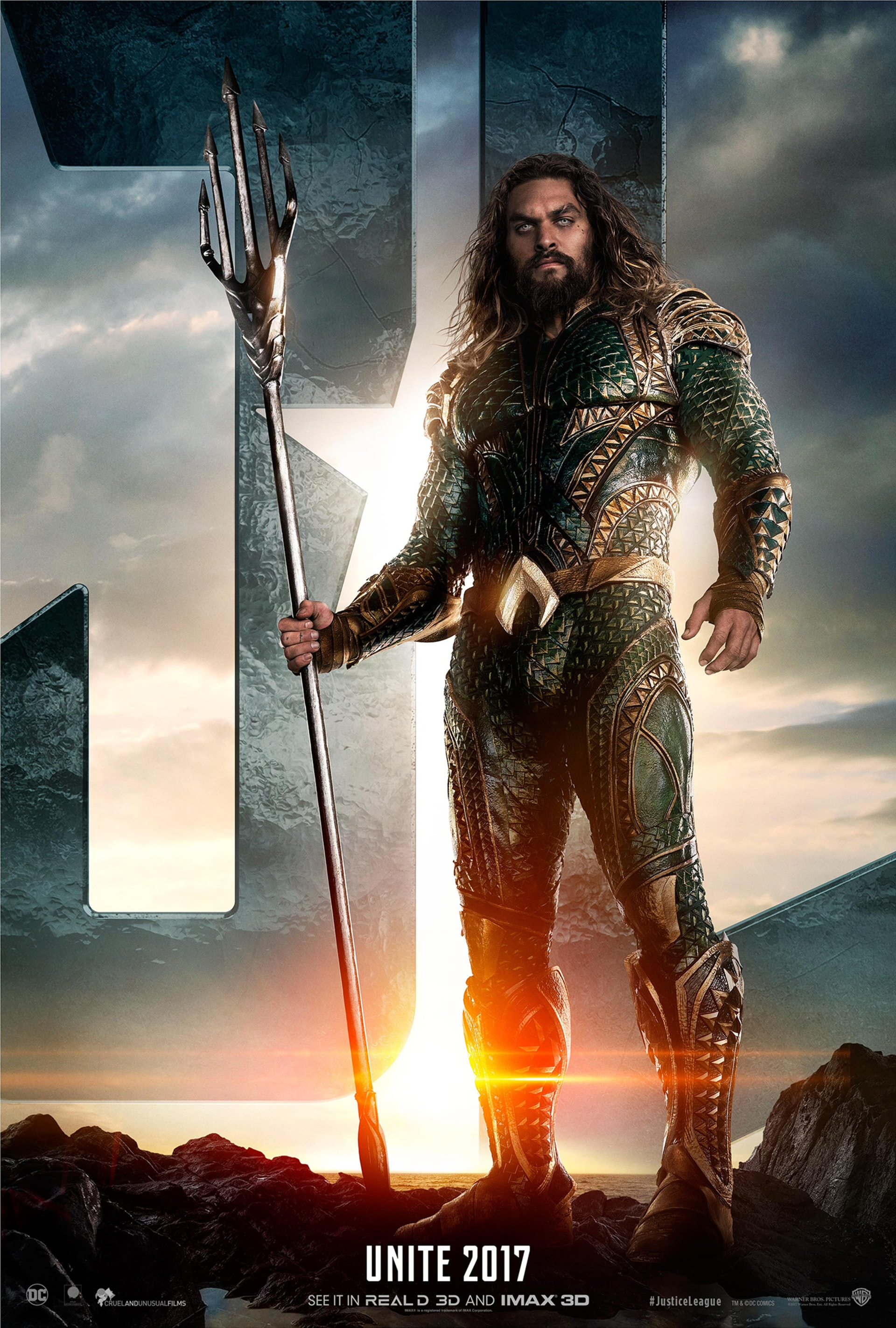 Aquaman standing in front of JL logo