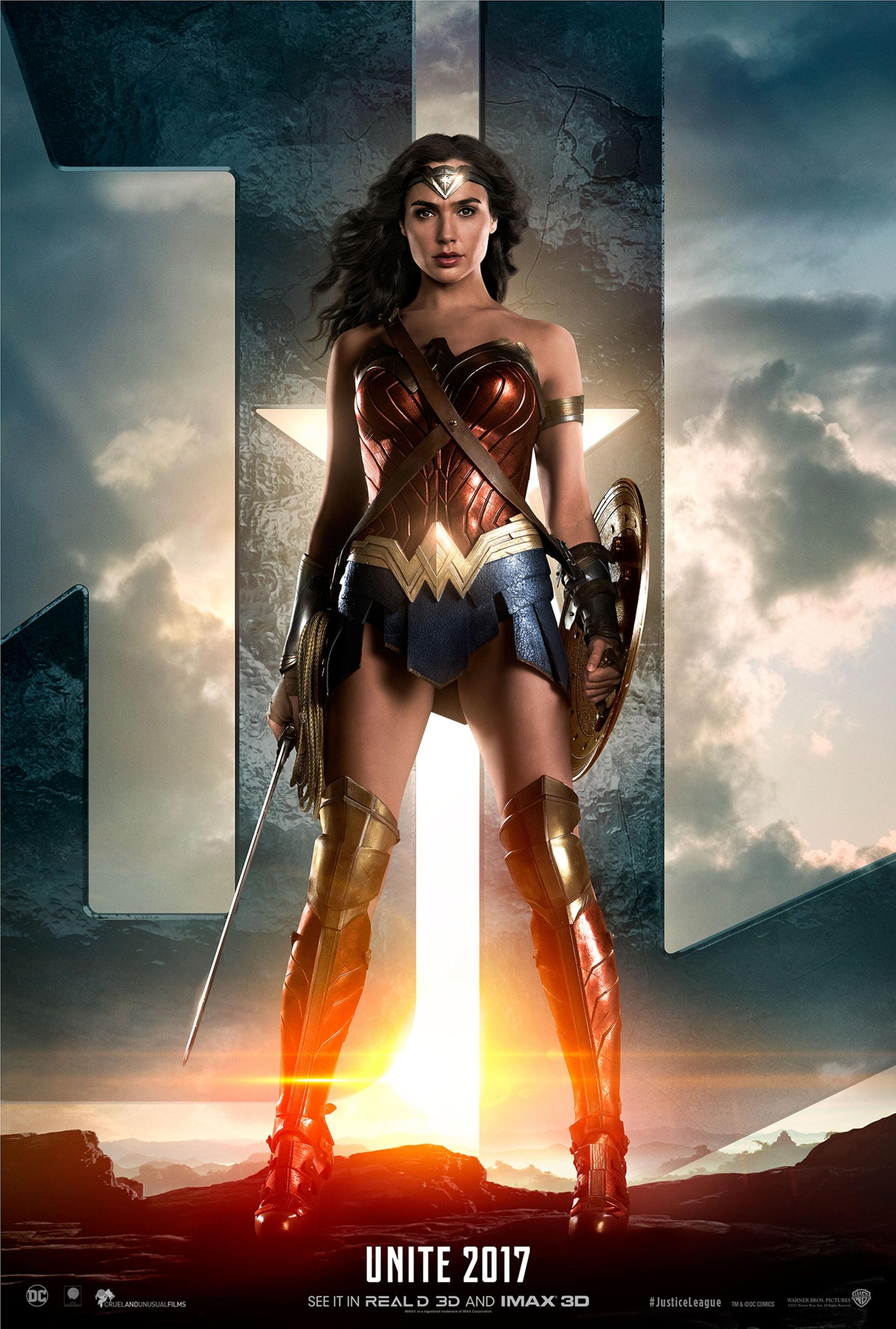 Wonder Woman standing in front of JL logo