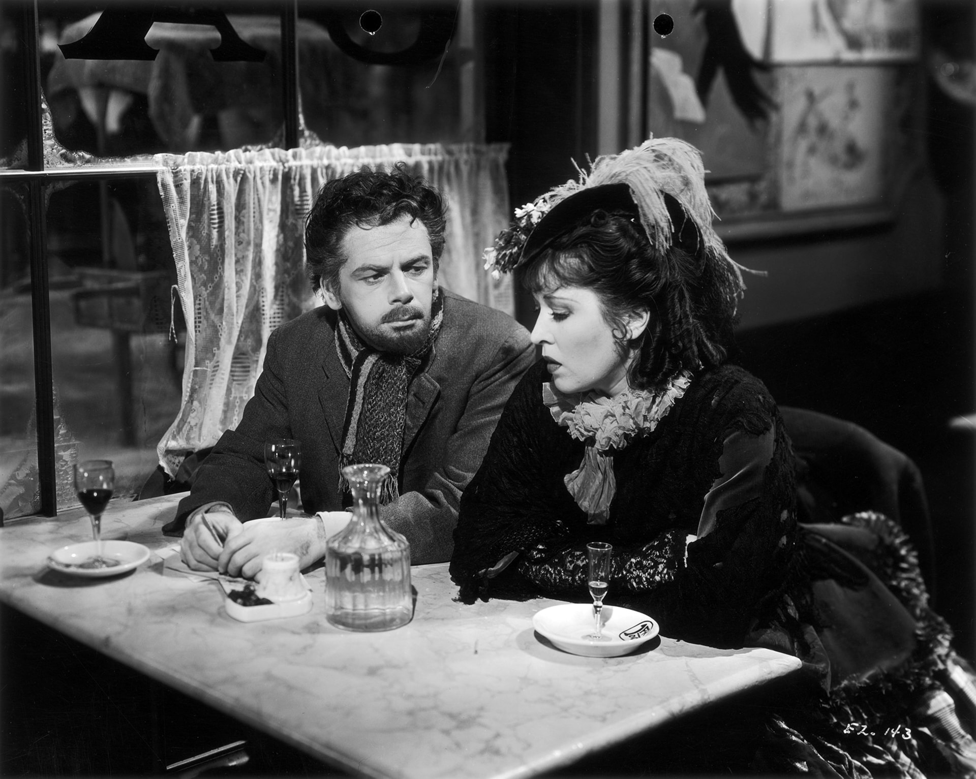 paul muni as emile zola with erin o'brien-moore as the prostitute who was the basis of Zola's bestseller, Nana.