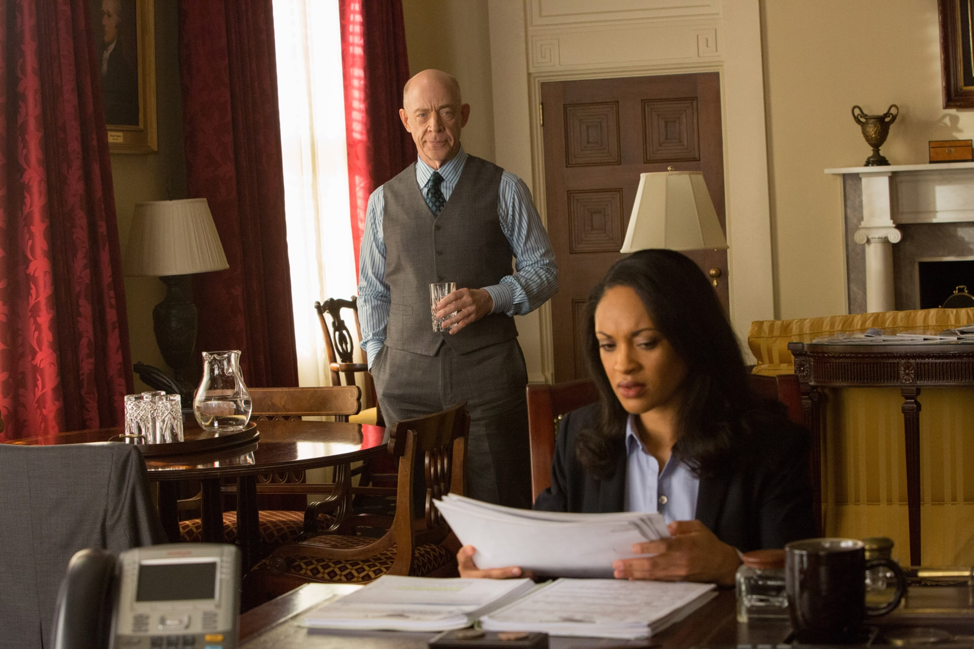 """J.K. SIMMONS as Ray King and CYNTHIA ADDAI-ROBINSON as Marybeth Medina in Warner Bros. Pictures' """"THE ACCOUNTANT,"""" a Warner Bros. Pictures release."""