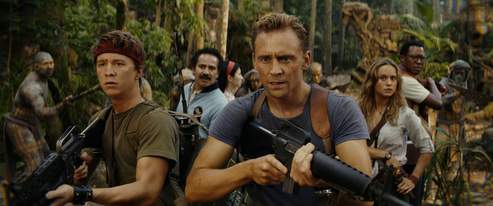 """THOMAS MANN as Slivko, JOHN ORTIZ as Victor, TOM HIDDLESTON as James Conrad and BRIE LARSON as Mason Weaver in Warner Bros. Pictures', Legendary Pictures' and Tencent Pictures' action adventure """"KONG: SKULL ISLAND,"""" a Warner Bros. Pictures release."""