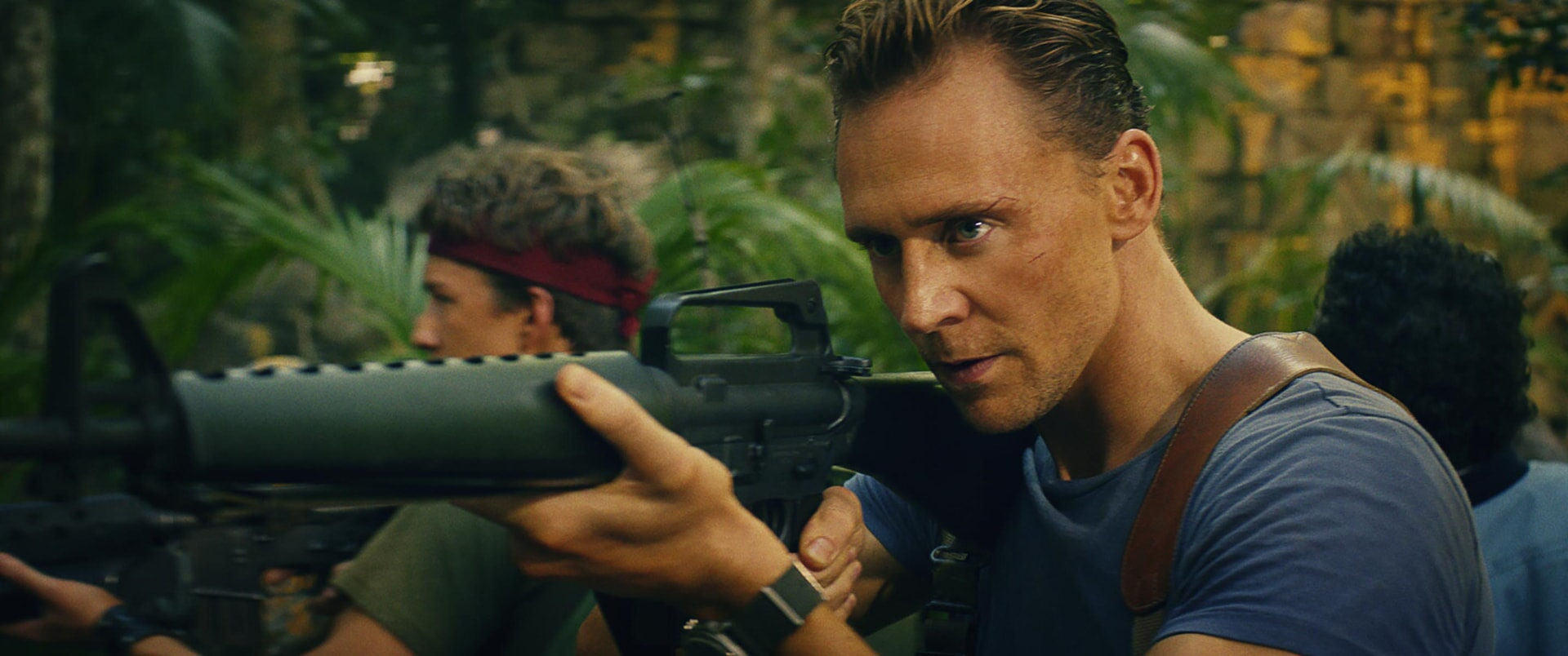 """THOMAS MANN as Slivko and TOM HIDDLESTON as James Conrad in Warner Bros. Pictures', Legendary Pictures' and Tencent Pictures' action adventure """"KONG: SKULL ISLAND,"""" a Warner Bros. Pictures release."""