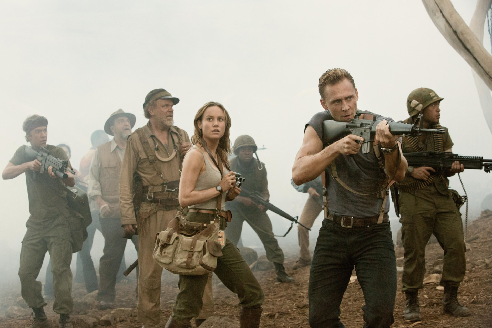 """THOMAS MANN as Slivko, JOHN GOODMAN as Bill Randa, JOHN C. REILLY as Hank Marlow, BRIE LARSON as Mason Weaver and TOM HIDDLESTON as James Conrad in Warner Bros. Pictures', Legendary Pictures' and Tencent Pictures' action adventure """"KONG: SKULL ISLAND,"""" a Warner Bros. Pictures release."""