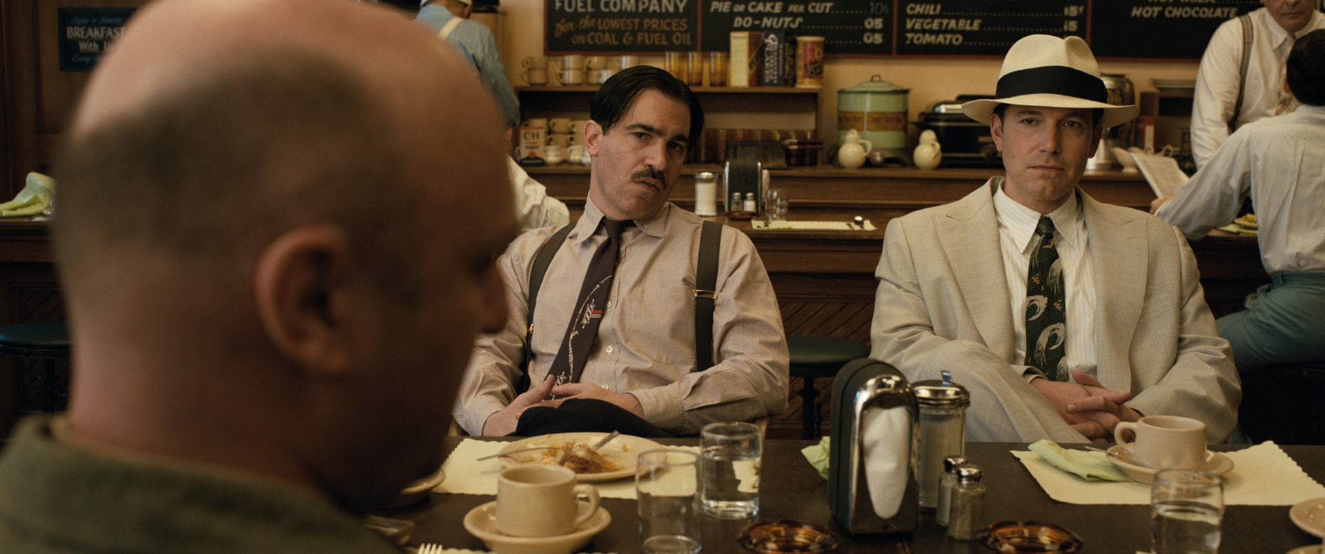 """CHRIS MESSINA as Dion Bartolo and BEN AFFLECK as Joe Coughlin in Warner Bros. Pictures' dramatic crime thriller """"LIVE BY NIGHT,"""" a Warner Bros. Pictures release."""