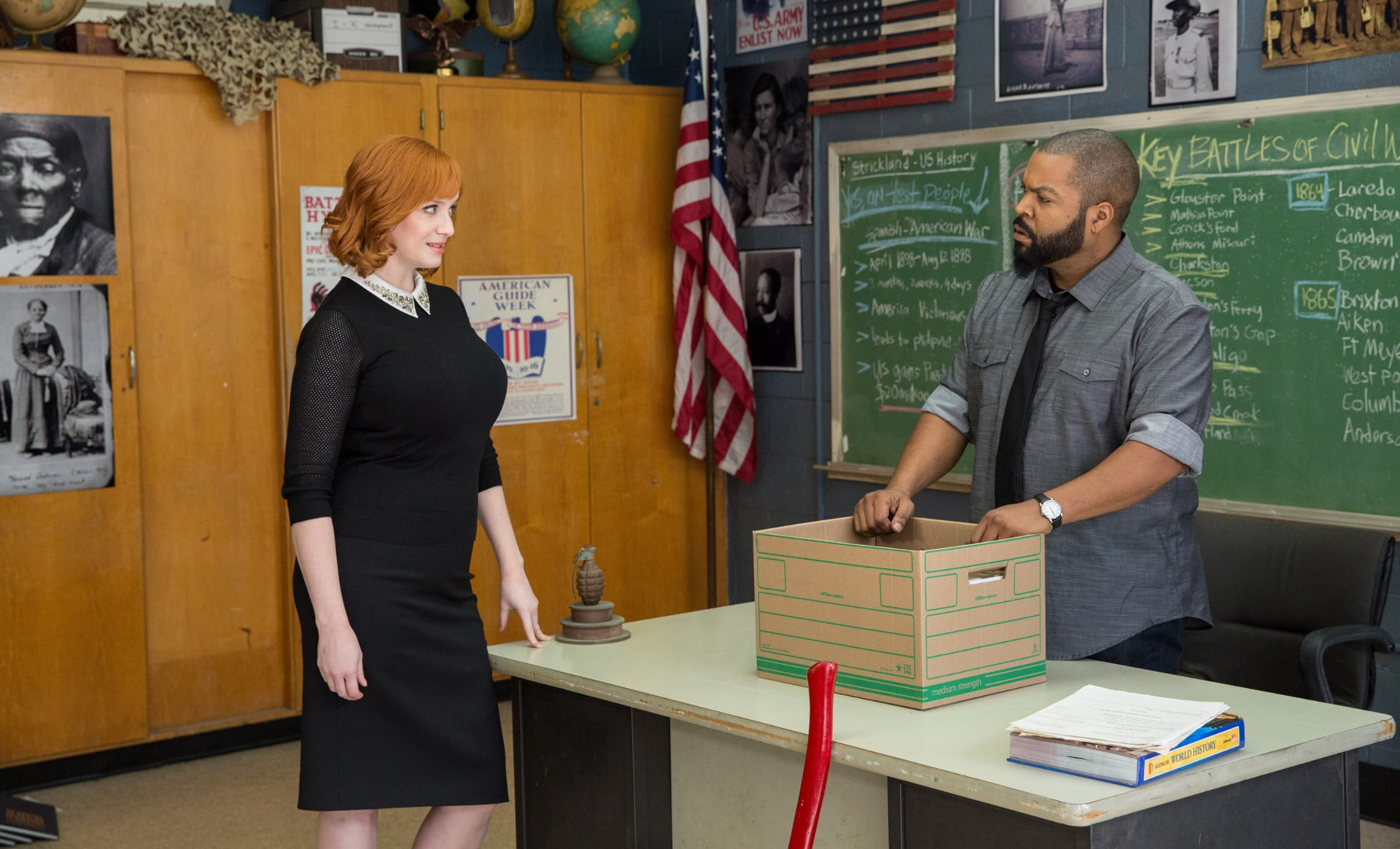 """CHRISTINA HENDRICKS as Ms. Monet and ICE CUBE as Strickland in the New Line Cinema and Village Roadshow Pictures comedy """"FIST FIGHT,"""" a Warner Bros. Pictures release."""