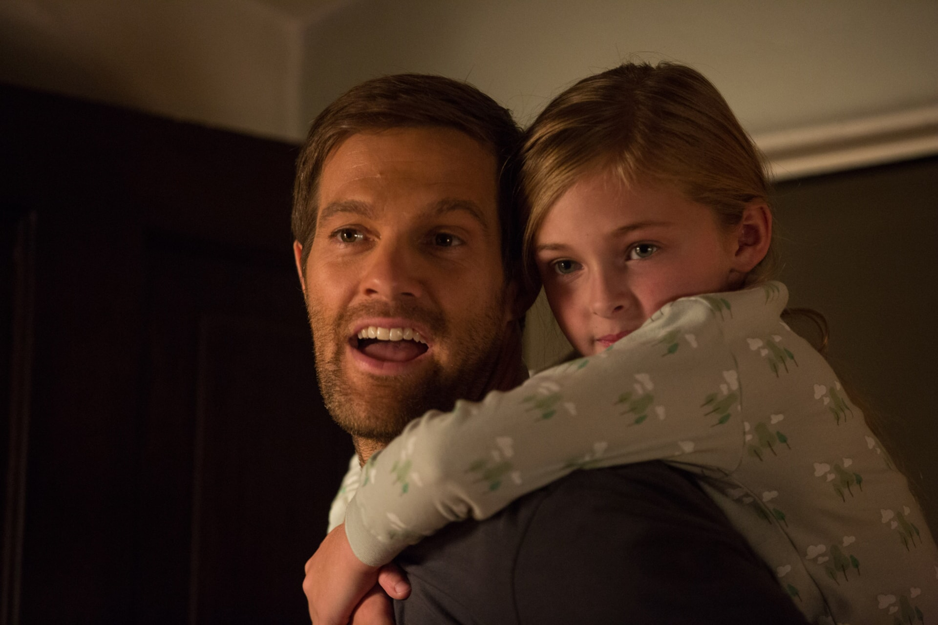 "GEOFF STULTS as David Connover and ISABELLA KAI RICE as Lily Connover in Warner Bros. Pictures' dramatic thriller ""UNFORGETTABLE,"" a Warner Bros. Pictures release."