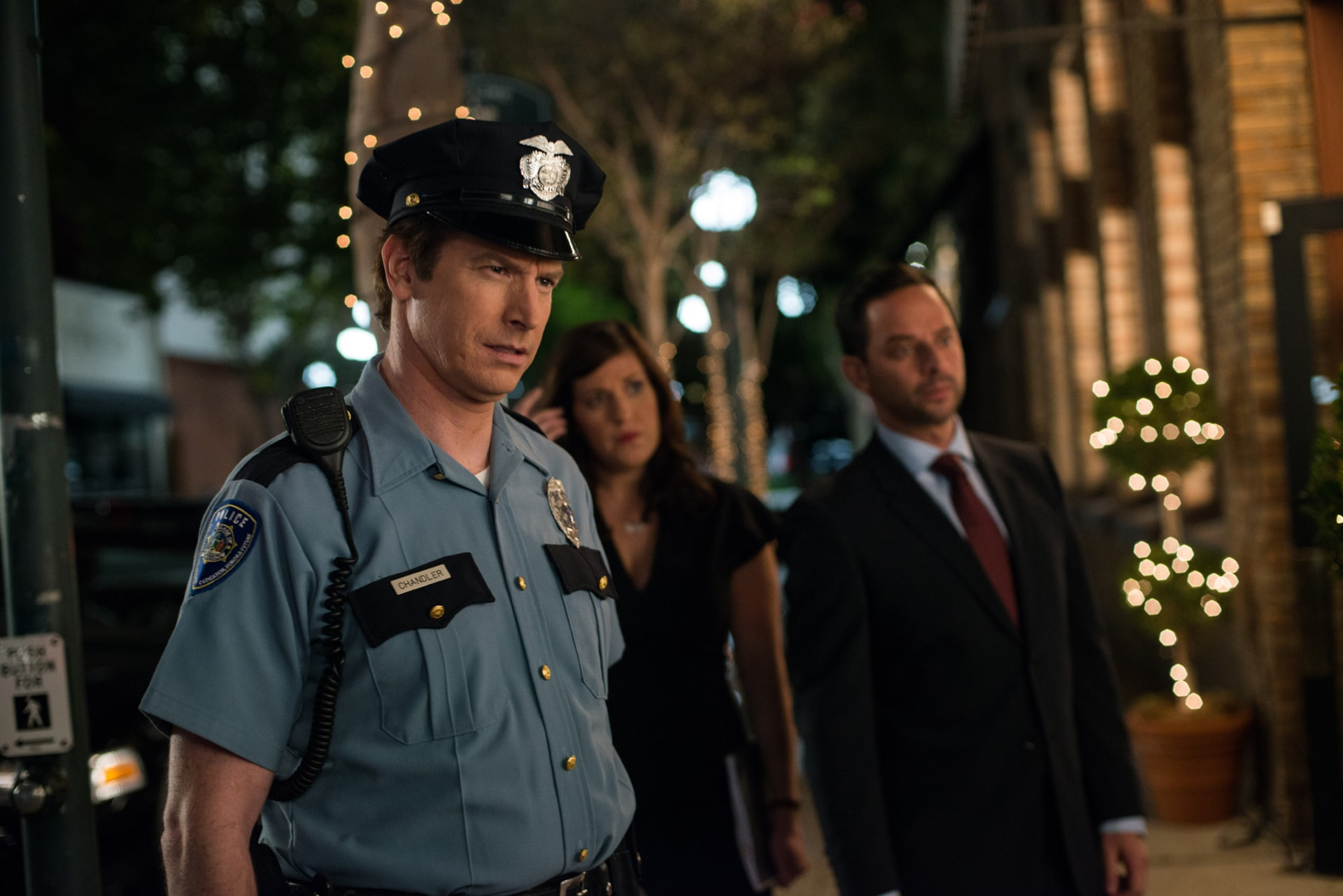 """ROB HUEBEL as Officer Chandler, ALLISON TOLMAN as Dawn and NICK KROLL as Bob in the New Line Cinema and Village Roadshow Pictures comedy """"THE HOUSE,"""" a Warner Bros. Pictures release."""