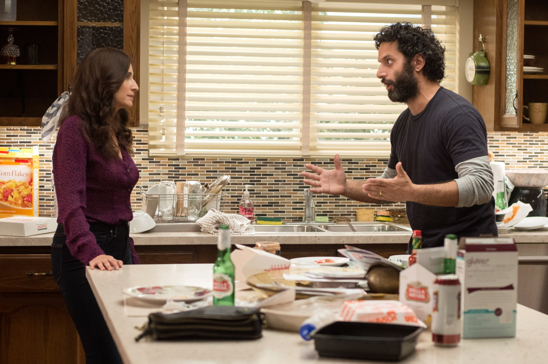 "MICHAELA WATKINS as Raina and JASON MANTZOUKAS as Frank in the New Line Cinema and Village Roadshow Pictures comedy ""THE HOUSE,"" a Warner Bros. Pictures release."