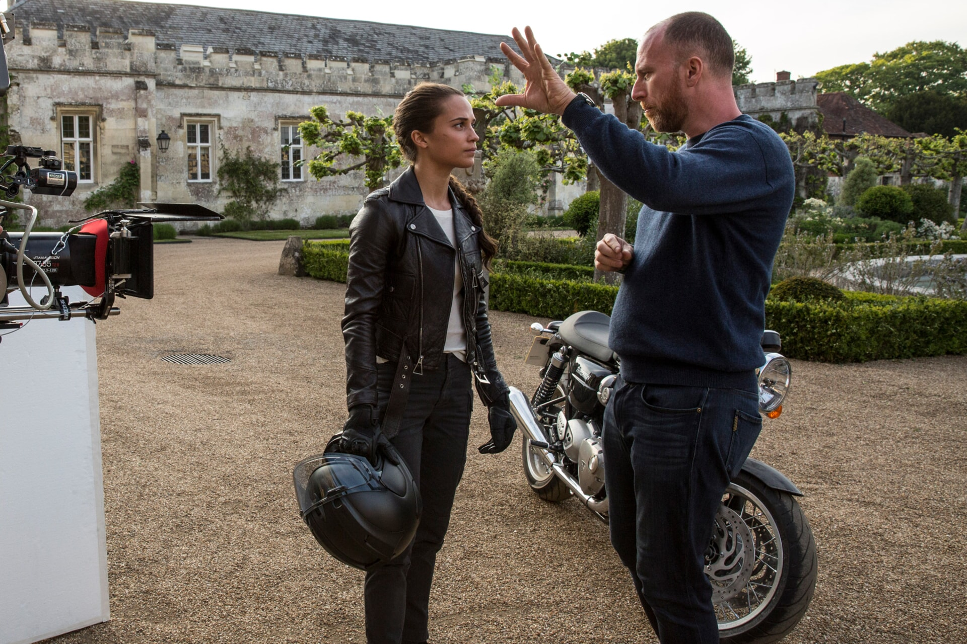 """(L-R) ALICIA VIKANDER and director ROAR UTHAUG on the set of Warner Bros. Pictures' and Metro-Goldwyn-Mayer Pictures' action adventure """"TOMB RAIDER,"""" a Warner Bros. Pictures release."""
