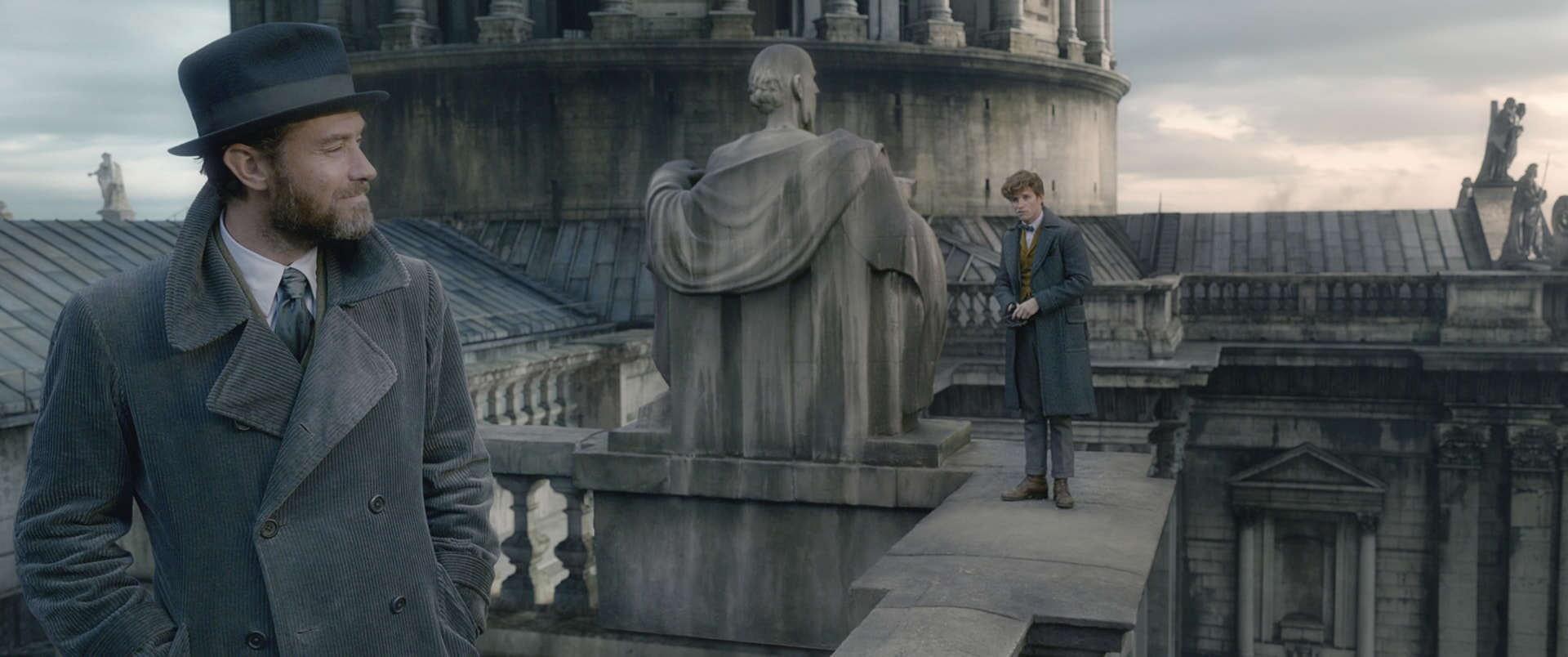 "(L-R) JUDE LAW as young ALBUS DUMBLEDORE and EDDIE REDMAYNE as Newt Scamander in Warner Bros. Pictures' fantasy adventure ""FANTASTIC BEASTS: THE CRIMES OF GRINDELWALD,"" a Warner Bros. Pictures release."