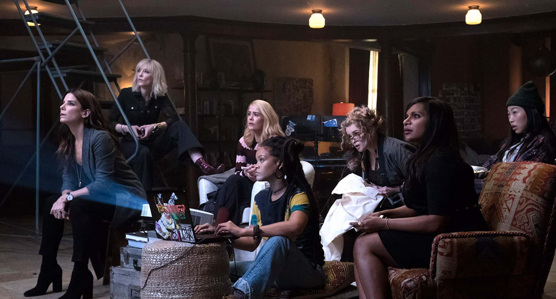 Cast of Ocean's 8 seated together in profile