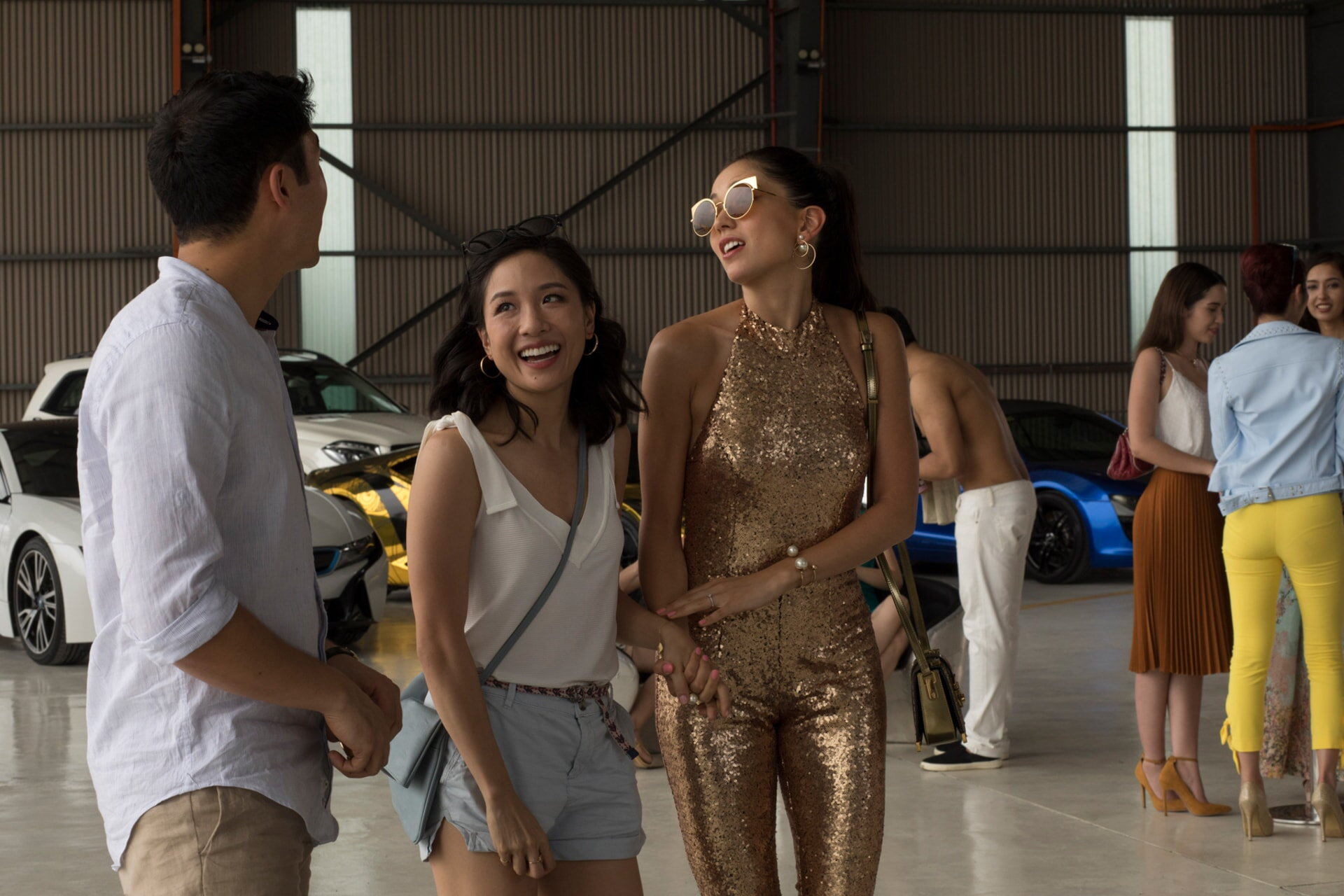 """(L-R) HENRY GOLDING as Nick, CONSTANCE WU as Rachel and SONOYA MIZUNO as Araminta in Warner Bros. Pictures' and SK Global Entertainment's contemporary romantic comedy """"CRAZY RICH ASIANS,"""" a Warner Bros. Pictures release."""