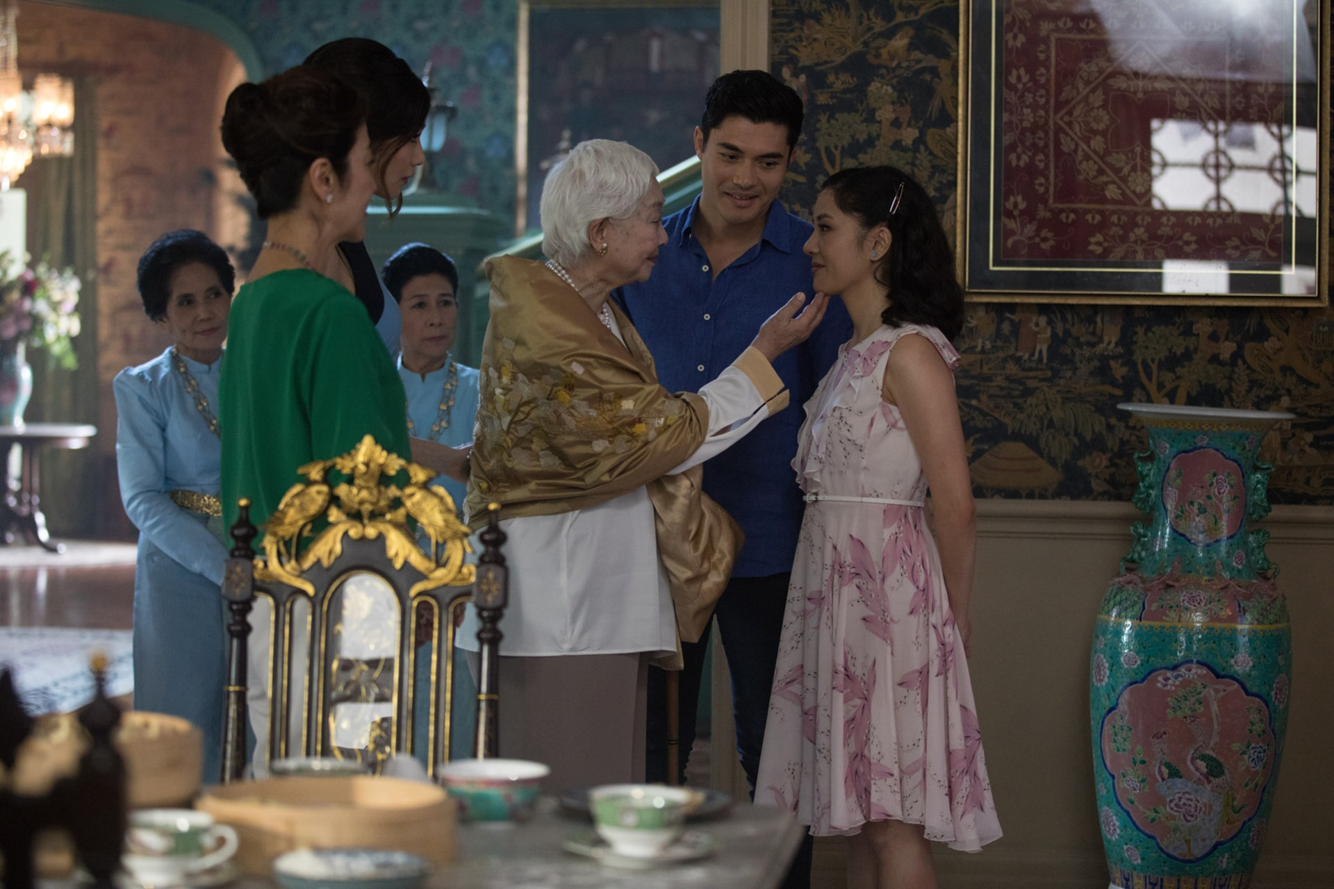 """(L-R) MICHELLE YEOH as Eleanor, GEMMA CHAN as Astrid, LISA LU as Ah Ma, HENRY GOLDING as Nick and CONSTANCE WU as Rachel in Warner Bros. Pictures' and SK Global Entertainment's contemporary romantic comedy """"CRAZY RICH ASIANS,"""" a Warner Bros. Pictures release."""