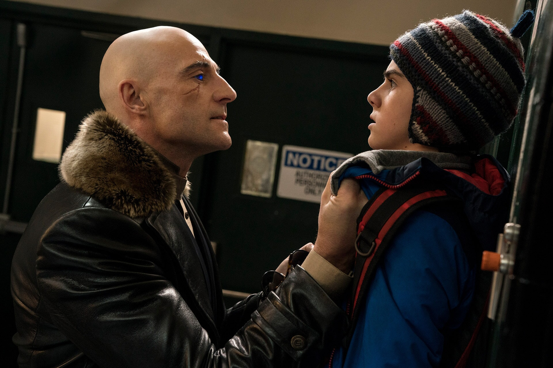 (L-r) MARK STRONG as Dr. Thaddeus Sivana and JACK DYLAN GRAZER as Freddy Freeman