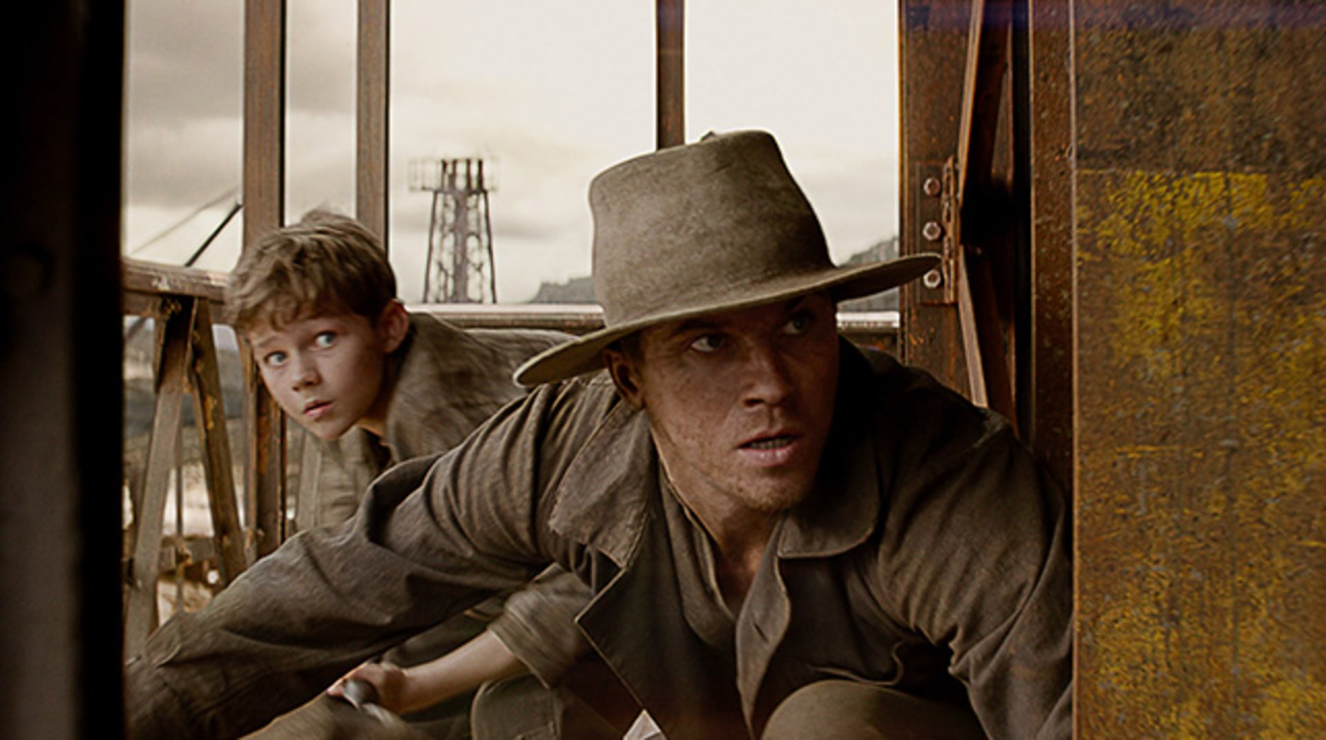 "LEVI MILLER as Peter and GARRETT HEDLUND as Hook in Warner Bros. Pictures' and RatPac-Dune Entertainment's action adventure ""PAN,"" a Warner Bros. Pictures release."