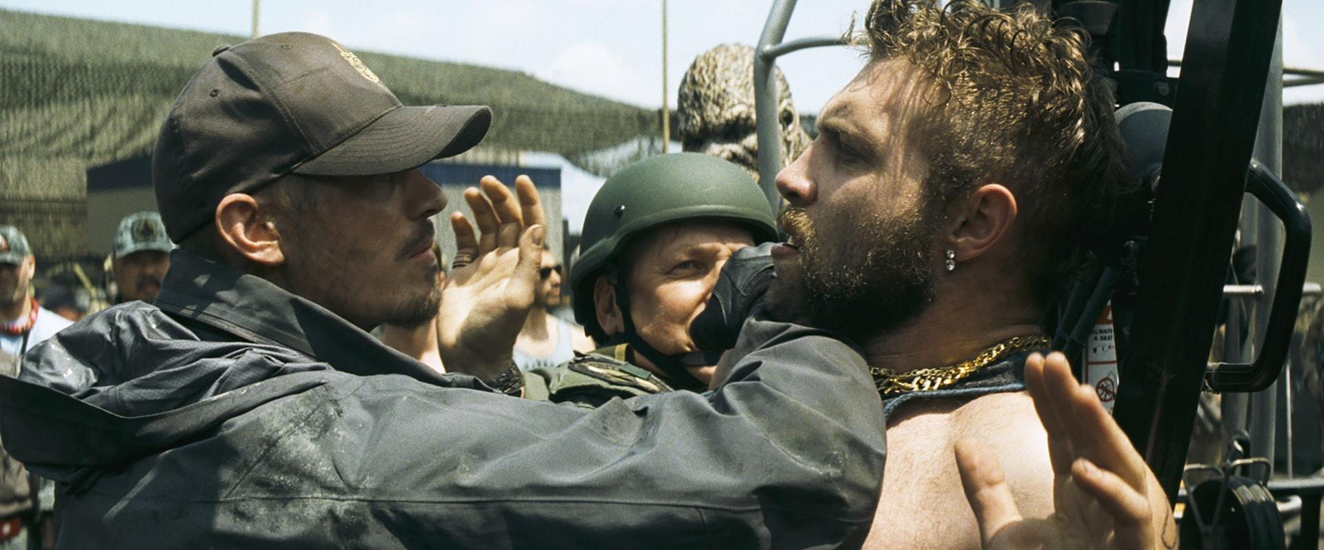 JOEL KINNAMAN as Rick Flag and JAI COURTNEY as Boomerang
