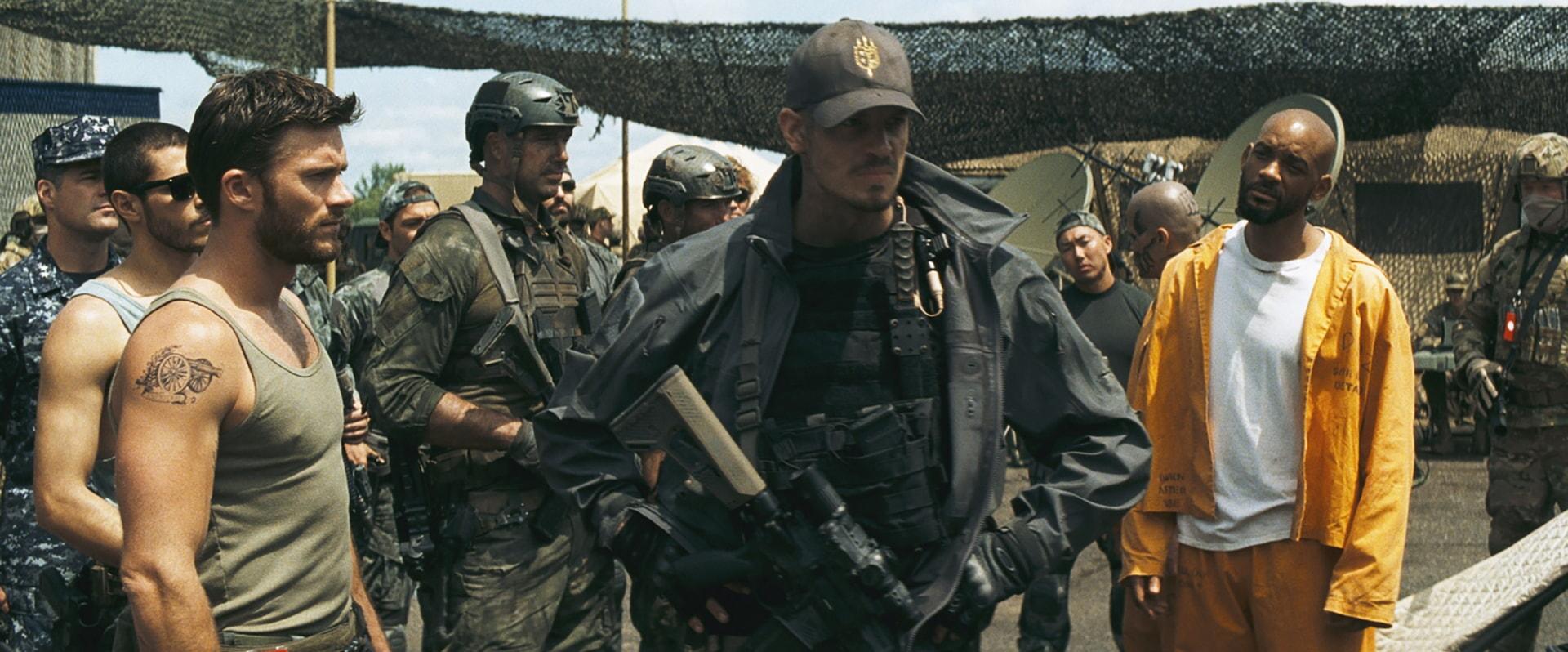 SCOTT EASTWOOD as Lieutenant GQ Edwards, JOEL KINNAMAN as Rick Flag and WILL SMITH as Deadshot