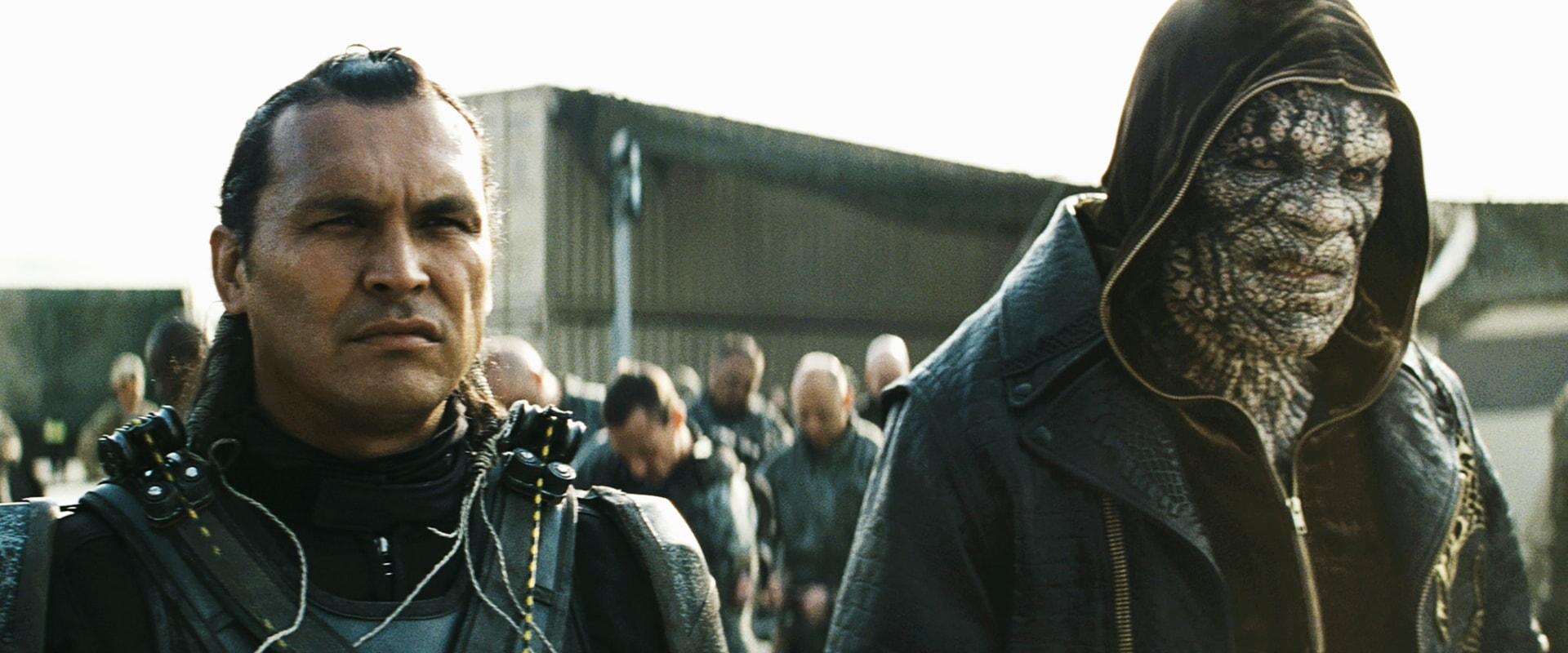ADAM BEACH as Slipknot and ADEWALE AKINNUOYE-AGBAJE as Killer Croc