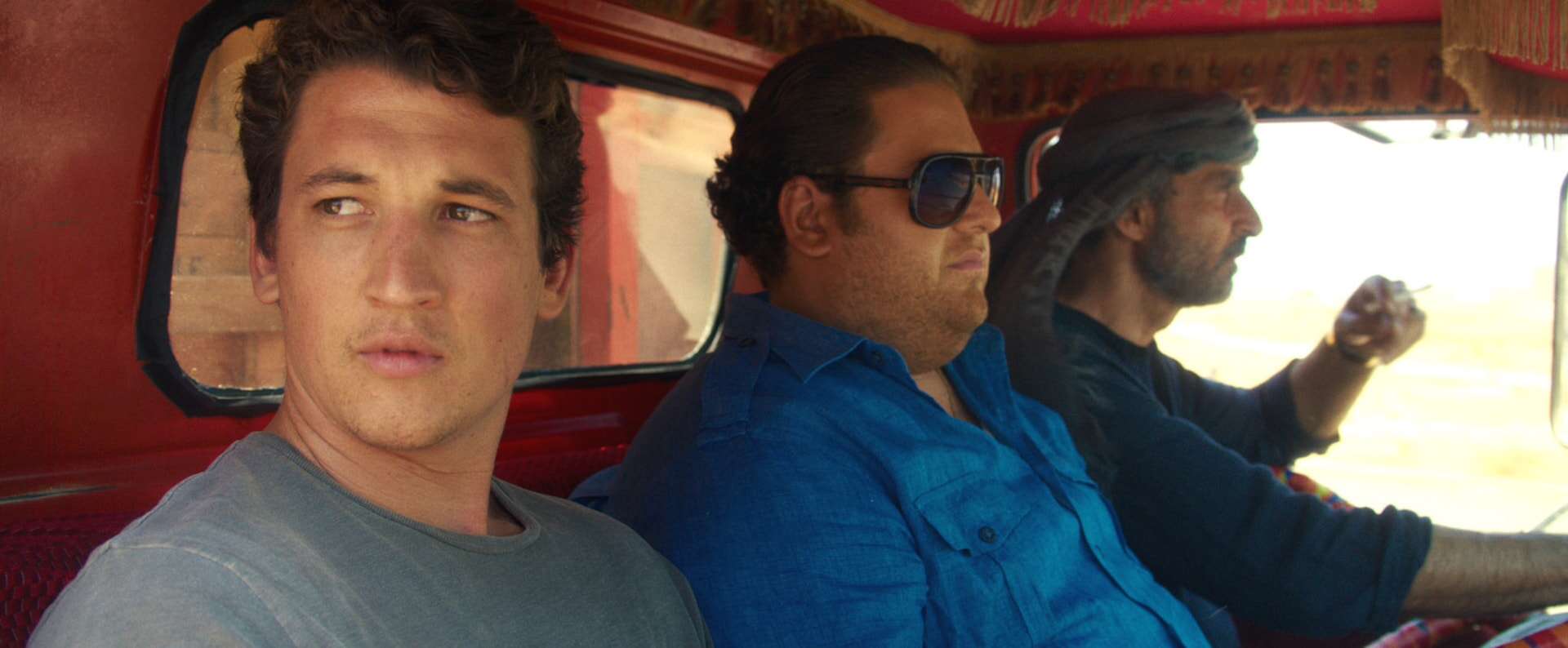"""MILES TELLER as David, JONAH HILL as Efraim and SHAUN TOUB as Marlboro in Warner Bros. Pictures' comedic drama (based on true events) """"WAR DOGS,"""" a Warner Bros. Pictures release."""