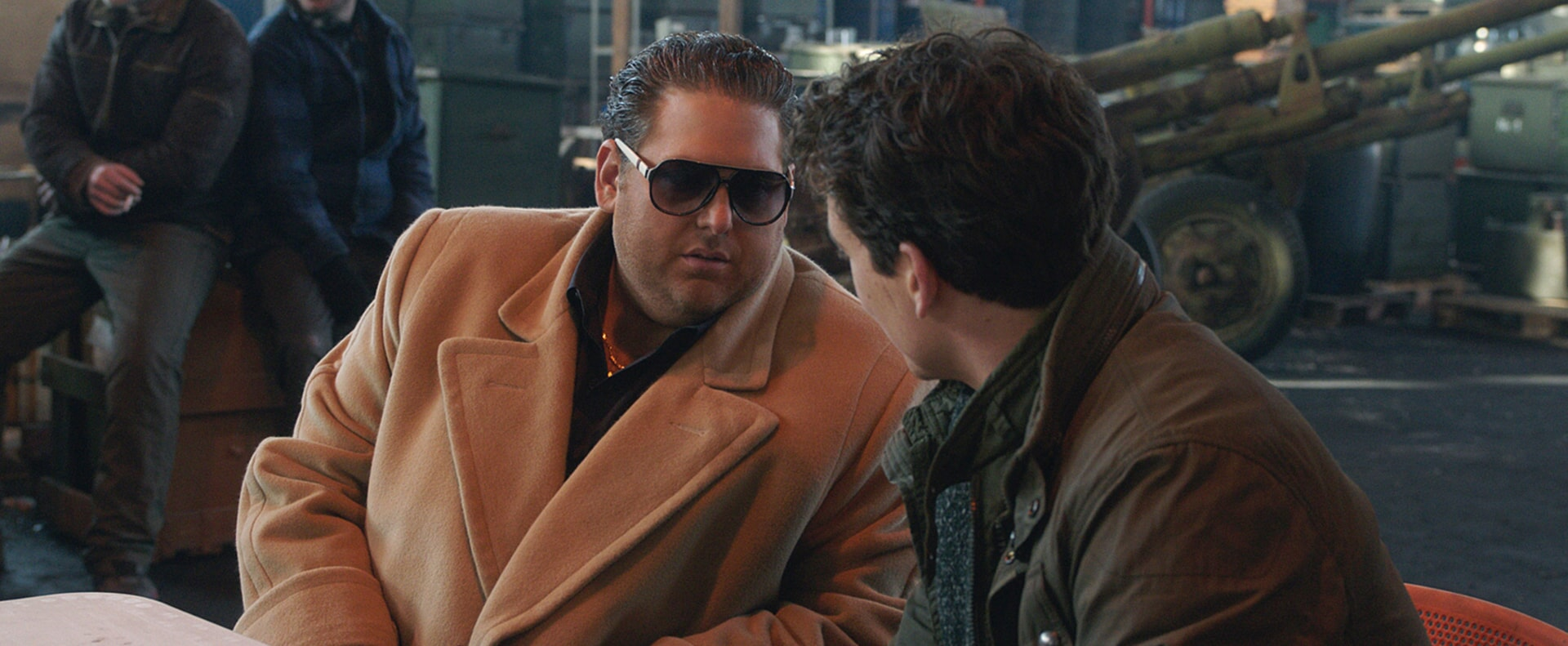 """JONAH HILL as Efraim and MILES TELLER as David in Warner Bros. Pictures' comedic drama (based on true events) """"WAR DOGS,"""" a Warner Bros. Pictures release."""