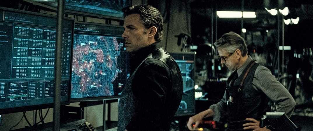 BEN AFFLECK as Bruce Wayne / Batman and JEREMY IRONS as Alfred
