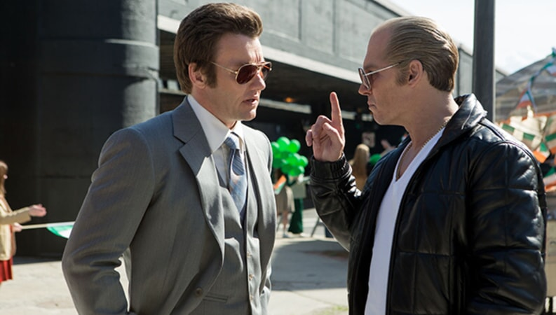"JOEL EDGERTON as FBI Agent John Connolly and JOHNNY DEPP as Whitey Bulger in the drama ""BLACK MASS."""