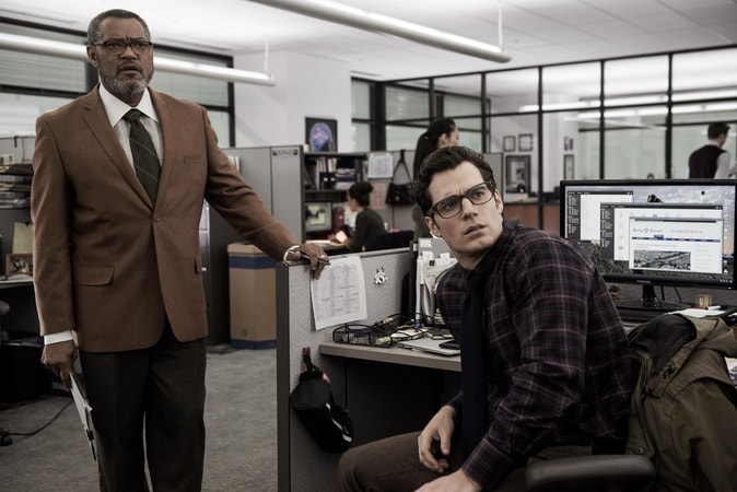 LAURENCE FISHBURNE as Perry White and HENRY CAVILL as Clark Kent