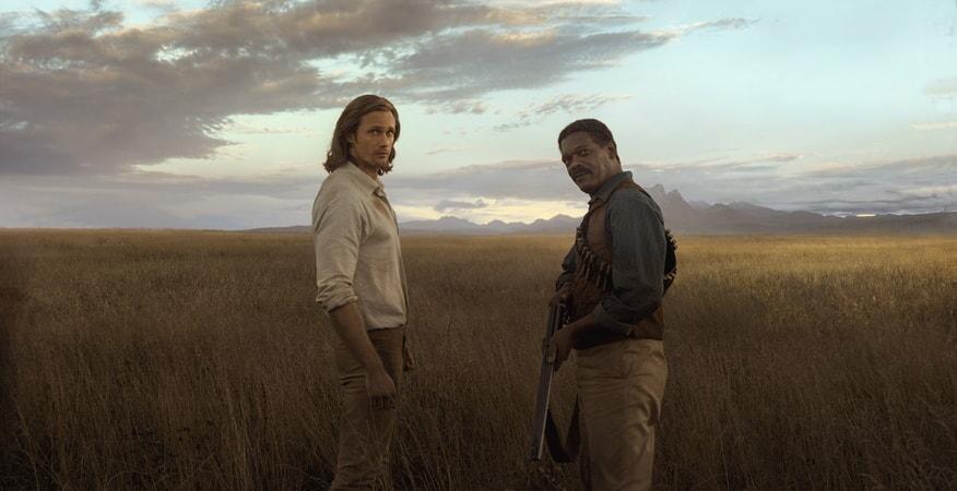 ALEXANDER SKARSGÅRD as Tarzan and SAMUEL L. JACKSON as George Washington Williams