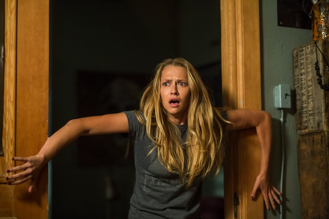 """TERESA PALMER as Rebecca in New Line Cinema's horror film """"LIGHTS OUT,"""" a Warner Bros. Pictures release."""