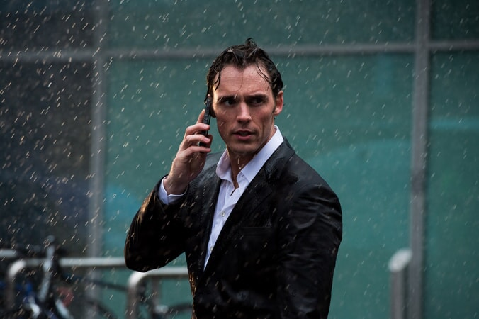 SAM CLAFLIN as Will Traynor in the rain holding a cell phone