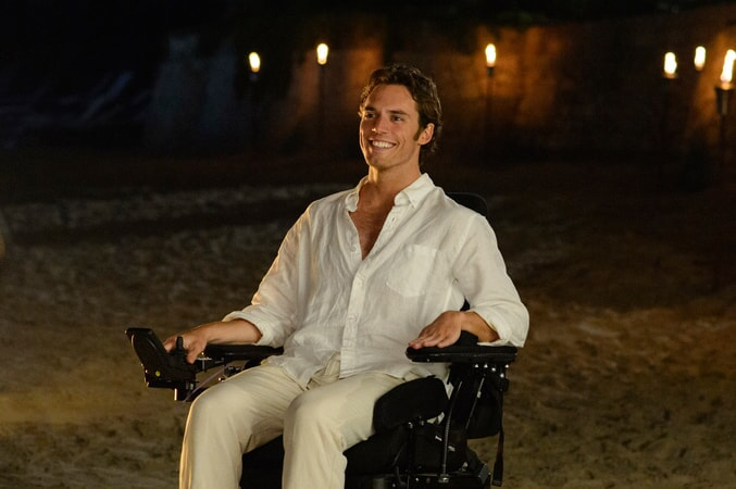 SAM CLAFLIN as Will Traynor on a beach at nighttime.