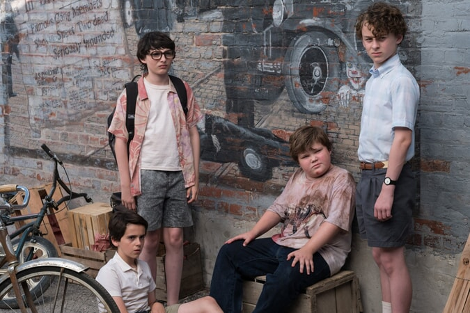 "JACK DYLAN GRAZER as Eddie Kaspbrak, FINN WOLFHARD as Richie Tozier, JEREMY RAY TAYLOR as Ben Hanscom and WYATT OLEFF as Stanley Uris in New Line Cinema's horror thriller ""IT,"" a Warner Bros. Pictures release."
