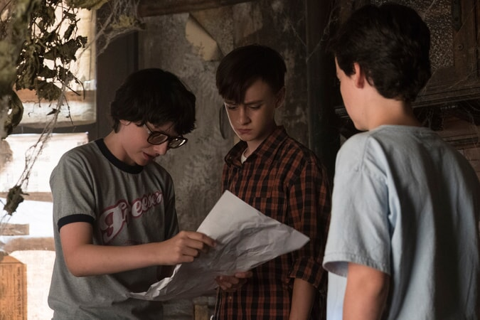 "FINN WOLFHARD as Richie Tozier, JAEDEN LIEBERHER as Bill Denbrough and JACK DYLAN GRAZER as Eddie Kaspbrak in New Line Cinema's horror thriller ""IT,"" a Warner Bros. Pictures release."