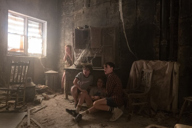 "SOPHIA LILLIS as Beverly Marsh, FINN WOLFHARD as Richie Tozier, JACK DYLAN GRAZER as Eddie Kaspbrak and JAEDEN LIEBERHER as Bill Denbrough in New Line Cinema's horror thriller ""IT,"" a Warner Bros. Pictures release."