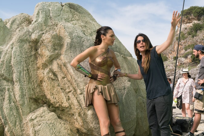 "GAL GADOT and director PATTY JENKINS on the set of the action adventure ""WONDER WOMAN,"" a Warner Bros. Pictures release."