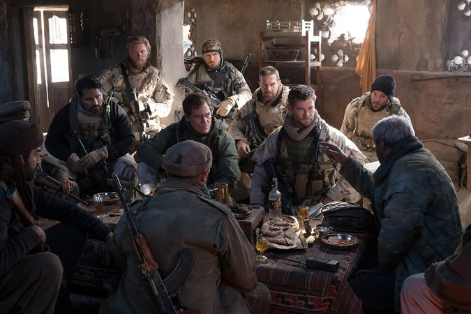 """MICHAEL PEÑA as Sam Diller, THAD LUCKINBILL as Vern Michaels, MICHAEL SHANNON as Cal Spencer, JACK KESY as Charles Jones, GEOFF STULTS as Sean Coffers, CHRIS HEMSWORTH as Captain Nelson and AUSTIN HÉBERT as Pat Essex in Jerry Bruckheimer Films', Black Label Media' and Alcon Entertainment's war drama """"12 STRONG,"""" a Warner Bros. Pictures release."""