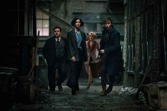 """DAN FOGLER as Jacob, KATHERINE WATERSTON as Tina, ALISON SUDOL as Queenie and EDDIE REDMAYNE as Newt in Warner Bros. Pictures' fantasy adventure """"FANTASTIC BEASTS AND WHERE TO FIND THEM,"""" a Warner Bros. Pictures release."""