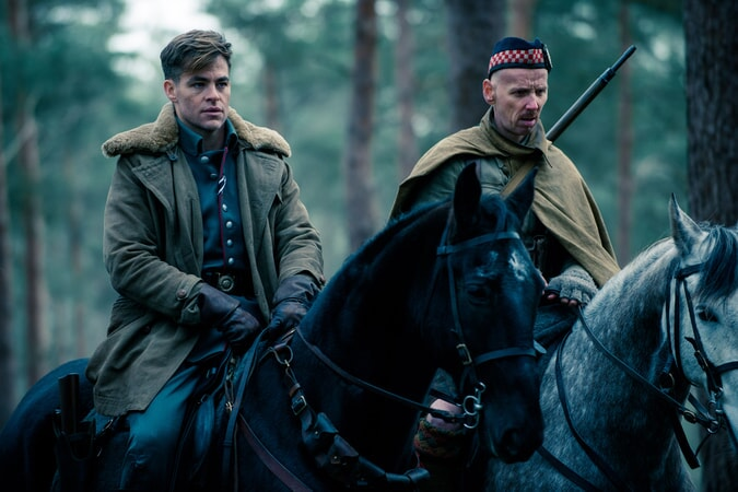 "CHRIS PINE as Steve Trevor and EWEN BREMNER as Charlie in the action adventure ""WONDER WOMAN,"" a Warner Bros. Pictures release."